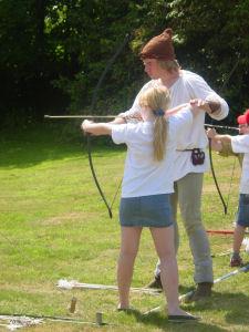 DD discovering archery