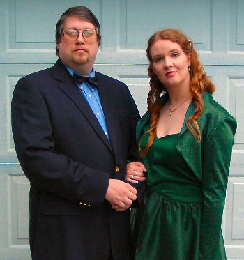 A handsome gent, and some strange lady in a green dress...